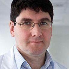 Приват-доцент, д.м.н. Акин Атмача